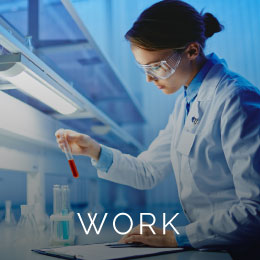Lady working in a dimly lit lab.