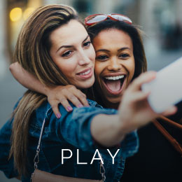 Two girls have fun taking a selfie photo in the innovation district.